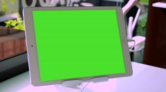 Tablet in holder - green screen - room  Stock Footage