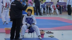 Female taekwondo player gets instructions from coach,Ubon Ratchathani,Thailand Stock Footage