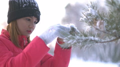 Asian Girl decorating Christmas tree in forest 4k UHD (3840x2160) Stock Footage