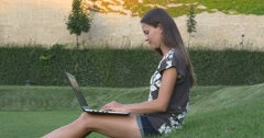 Woman with laptop considering strategy Stock Footage
