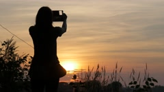 Silhouette of woman making photo with phone,Ubon Ratchathani,Thailand Stock Footage
