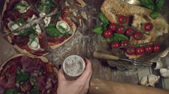 4k Traditional Italian Food and Beer, Taking the Glass Stock Footage