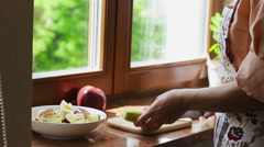 Girl brushing her banana for cooking Stock Footage