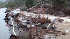 A flood causes severe damage along roadways in Colorado. Stock Footage