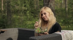 Woman Eating a Vegetarian Salad on Nature. Camping, Tourist Stock Footage