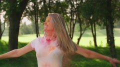 Close-up, European young beautiful girls having fun in the Park with the colors Stock Footage