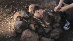 A Man a Fish Fry on the Grill Over a Fire Stock Footage
