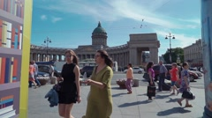 Crowds of people walk in front Kazan cathedral in Saint Petersburg. Summer. Cars Stock Footage
