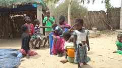 Poor African children in a village - Wolof ethnic group, Lake Retba, Senegal Stock Footage