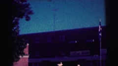 1968: plane's landing behind a warehouse Stock Footage