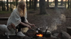 Woman Roasting Marshmallow Over Campfire Stock Footage