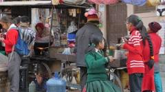 Schoolgirls eating at street stall,Kathmandu,Nepal Stock Footage