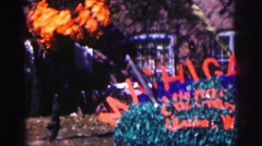 1968: displaying michigan pride on front lawn Stock Footage