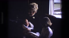 1973: showing off the new baby to his big sister. Stock Footage