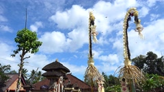 Bamboo pole decorated with coconut leafs and offerings at the end (Penjor) Stock Footage