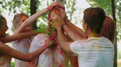 Close-up of the model many hands stain the face of your friends with colors. Stock Footage