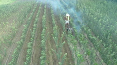 Aerial view of young trees during gardener cultivation land by Cutter. Stock Footage
