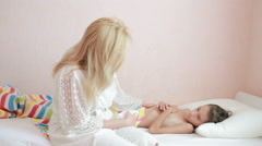 Mother treats a sick child. Mom helping a little girl to recover Stock Footage