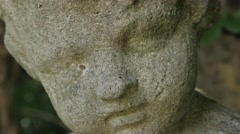 Closeup on Head of Stone Statue Stock Footage