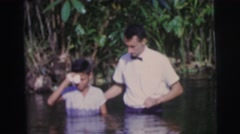 1979: wading in water Stock Footage