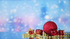 Christmas decorations and snowfall on background seamless loop Stock Footage