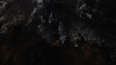 At Batu Caves, Malaysia seen stalactites and stalagmites, interior of cave and Stock Footage