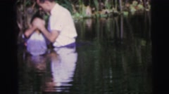 1979: three young people of different origins being baptized in a body of water Stock Footage