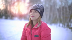 Young Thai Woman throwing up snow slowmotion Stock Footage
