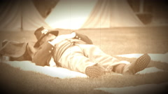 Civil War soldier napping in camp (Archive Footage Version) Stock Footage