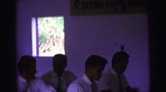 1979: 10 boys and 10 girls in uniforms sitting in classroom Stock Footage