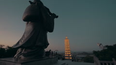 Back of Buddha and pagoda on the background at night in Bai Dinh temple. Hanoi Stock Footage