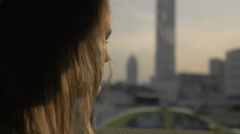 Woman looking out the window during bus ride in Bangkok, Thailand Stock Footage