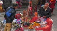 Nepali hindu priest joking with boy,Dakshinkali,Nepal Stock Footage
