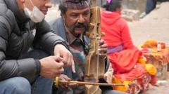 Nepali man making traditional music,Dakshinkali,Nepal Stock Footage