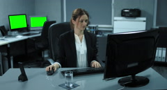 4K: A young woman is sitting at her computer. Stock Footage