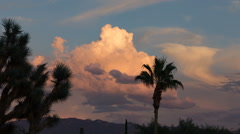 Sunset colored clouds over mountain time lapse Stock Footage