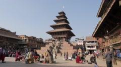 Woman sitting on Taumadhi Tole square,Bhaktapur,Nepal Stock Footage