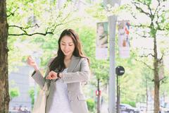 Japanese attractive businesswoman in downtown Tokyo Stock Photos