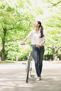 Japanese attractive woman in a city park Stock Photos