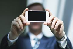 Caucasian businessman with phone in modern office Stock Photos