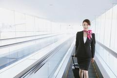 Japanese attractive flight attendant at the airport Stock Photos