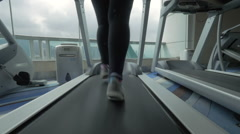 Woman training on treadmill and enjoying cityscape Stock Footage