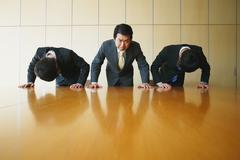 Japanese businessmen apologizing Stock Photos