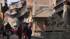 Lion statues in busy pedestrian street,Bhaktapur,Nepal Stock Footage