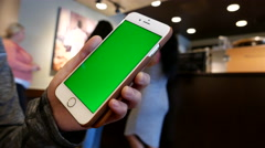 Hand holding green screen iphone inside Starbucks store Stock Footage