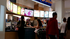 People line up for buying juice at food court area Stock Footage
