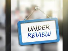 Under review hanging sign Stock Illustration