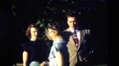 1951: a family seen with people posing for camera well suited up WILLMAR Stock Footage