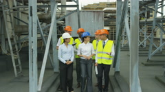 4K Portrait smiling multiracial team of engineers at industrial site Stock Footage