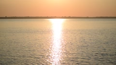 Silhouette of man rowing in small rubber boat at dawn Arkistovideo